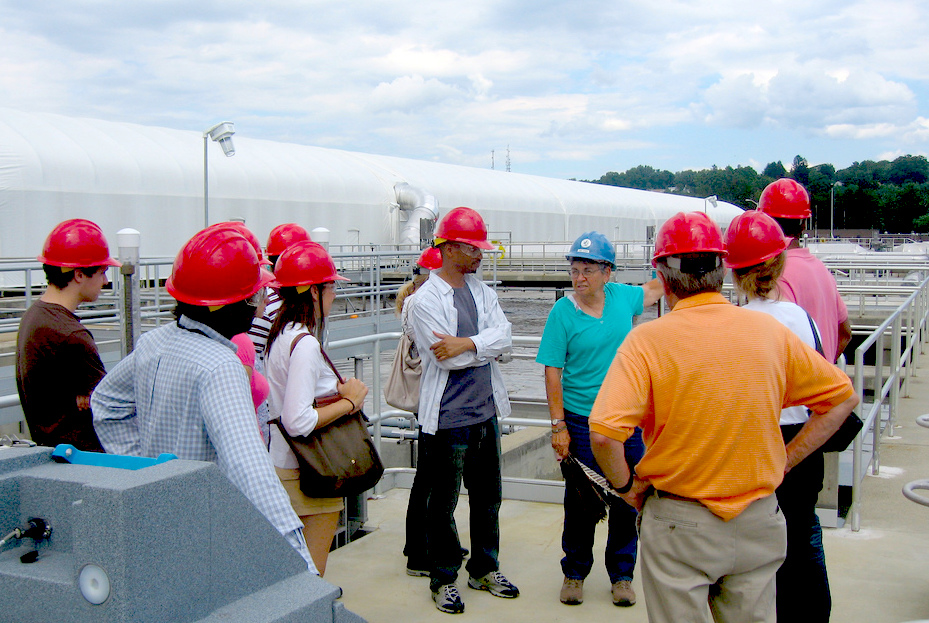 Municipal officials meet with MassDEP staff and interns at a wastewater treatment facility.